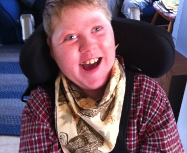 Please vote to help this great kid win a new wheelchair accessible van. Afterward, please reblog. More votes can help this family get the van.  Earlier, whilst scrolling through my Facebook, I came across a post from Indie Game HQ. This is Colin McCarthy. Colin suffers from Lennox-Gastut Syndrome. This has caused a lot of issues for this young gentleman. So why should we care? He is a family member of one of the great gentlemen at Indie Game HQ. On top of that, there is just a need of a simple vote to help Colin and his family win a new wheelchair accessible van.  If you could, please go vote here:  http://www.mobilityawarenessmonth.com/entrant/colin-mccarthy-greenfield-ma/ Here is a little more information on Colin and what this amazing kid has gone through: Hi- my name is Colin McCarthy. Winning a wheelchair accessible van would enable me to spend more time in the community, with my family and with my friends. I love to be around people, the more the merrier! The older and bigger I get the more challenging it becomes to get me into my car seat and lifting my wheelchair into the back of the van is not easy either. But despite the challenge- my Mom, Dad and brother Shane do their best to take me wherever they go. They get me to every family celebration there is, they take me to Mt. Sunapee in New Hampshire to ski with the New England Handicapped Sports Association, on vacation to Cape Cod, to soccer games to cheer on my brother, I like to go bowling, to the zoo, apple picking and trips to the mall. I have been on a whale watch, and to a Red Sox game. I go to the Greenfield Middle School where I am a 6th grader and am surrounded by great friends that help make my world a better place. I also go to lots of doctor's appointments. You see I am a 12 year old nonverbal and non-ambulatory boy that relies on adult assistance for everything I need. I was born with a rare brain disorder called Semilobar holoprosencephaly, this fusion of the frontal lobes of my brain has caused bi-lateral hearing loss, cortical vision impairment, dental abnormalities, respiratory challenges, feeding problems, Diabetes Insipidus, and a form of Epilepsy called Lennox-Gastut Syndrome which causes constant seizure activity in my brain. My 12 years thus far have been a bit of a challenge to say the least. My family believes that I have a lot to teach others- many have said I bring out the best in the people around me. Despite my daily challenges I try to keep a smile on my face and bring a smile to those around me. I have a laugh that usually gets anybody that hears me laughing as well. We believe that people need to see different abled people out in the world doing ordinary things. Being a winner of an accessible van would make that possible- it would get me to where the action is and definitely keep me smiling. Please vote for me.