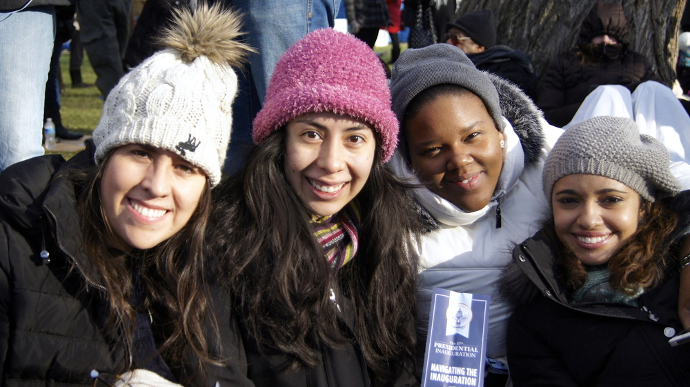 Four Lynn University and WII students wait in the January cold on the National Mall's lawn for Obama's second inaugural address.