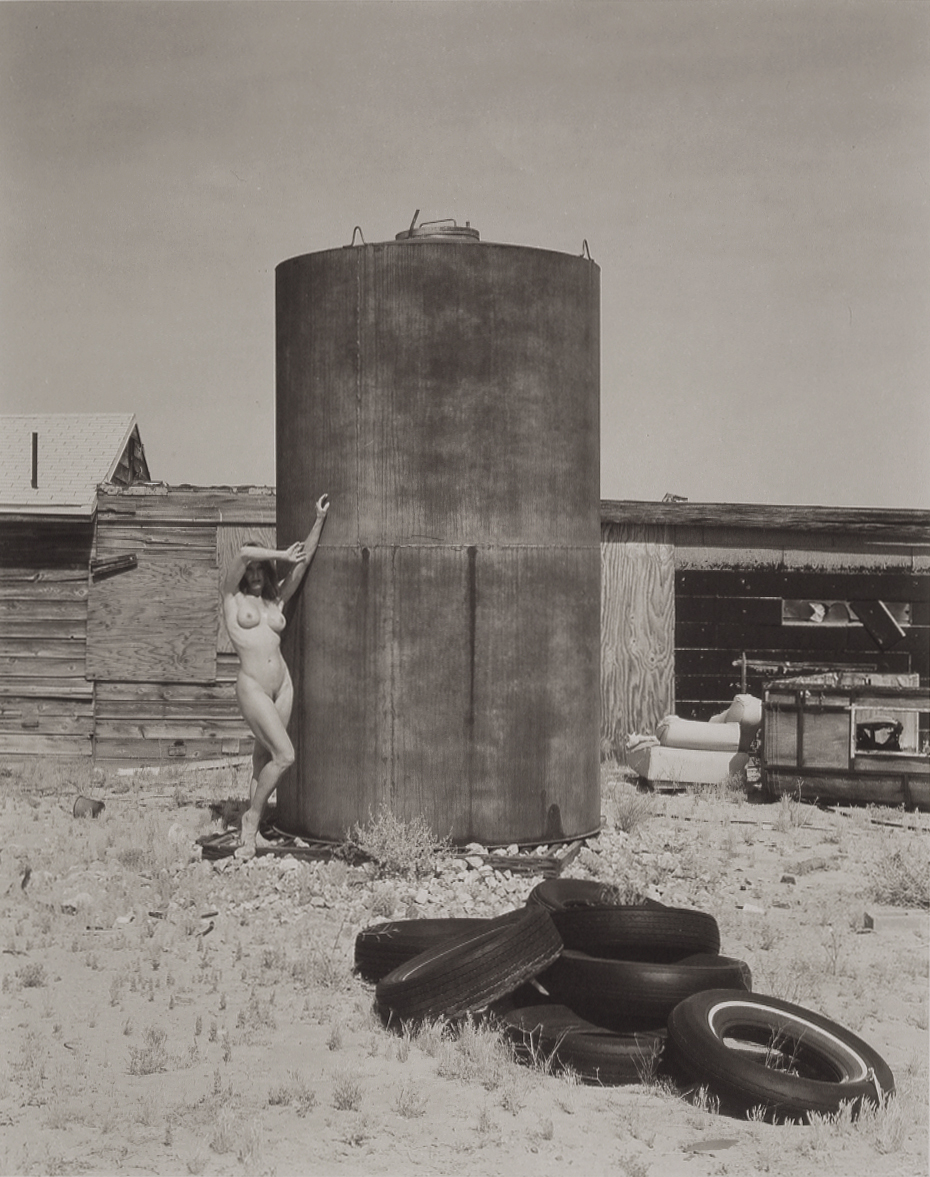 3-Portrait of Heidi by Water Tank and Tires.jpg