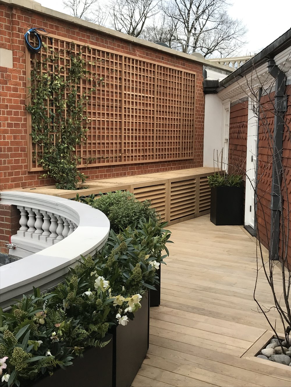 Terrace garden deck, trellis and and air conditioning unit covers in Wibledon