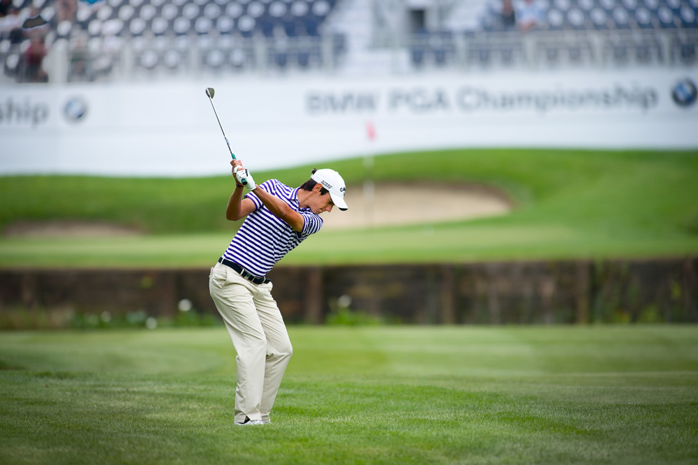 Matteo Manassero PGA champion 2013 plays to a tight pin at the last