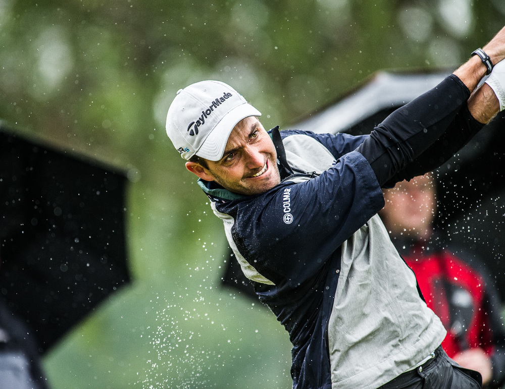 Like water off a ducks back, Edoardo Molinari battled in vain in the torrential rain.
