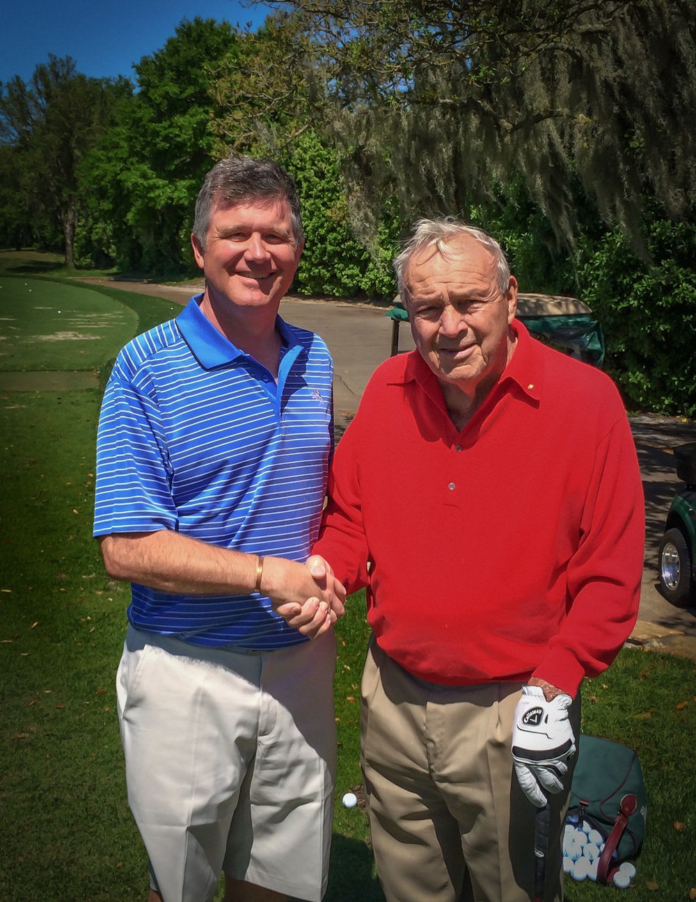 Arnold Palmer wishing Phill good luck for the trip after their latest practice session together.