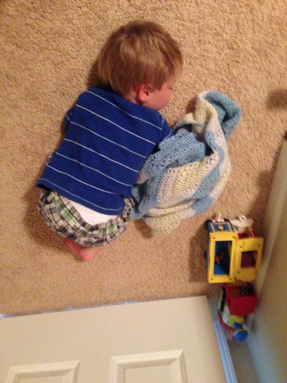 ben's favorite napping position. by the door with his blankie.