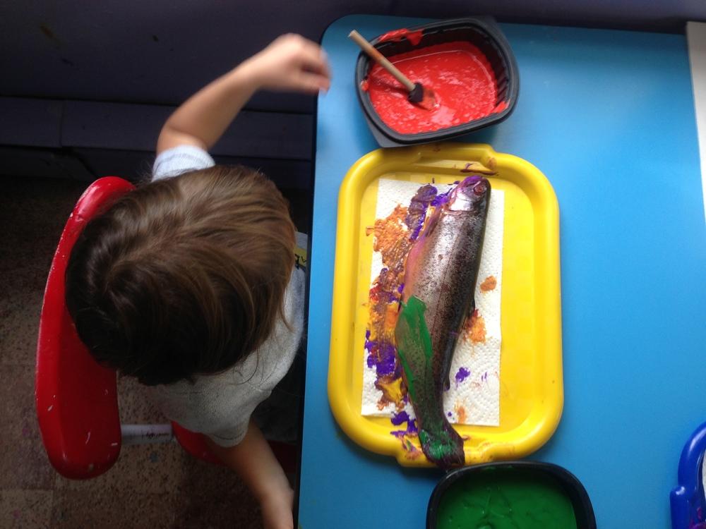 painting fish at preschool.