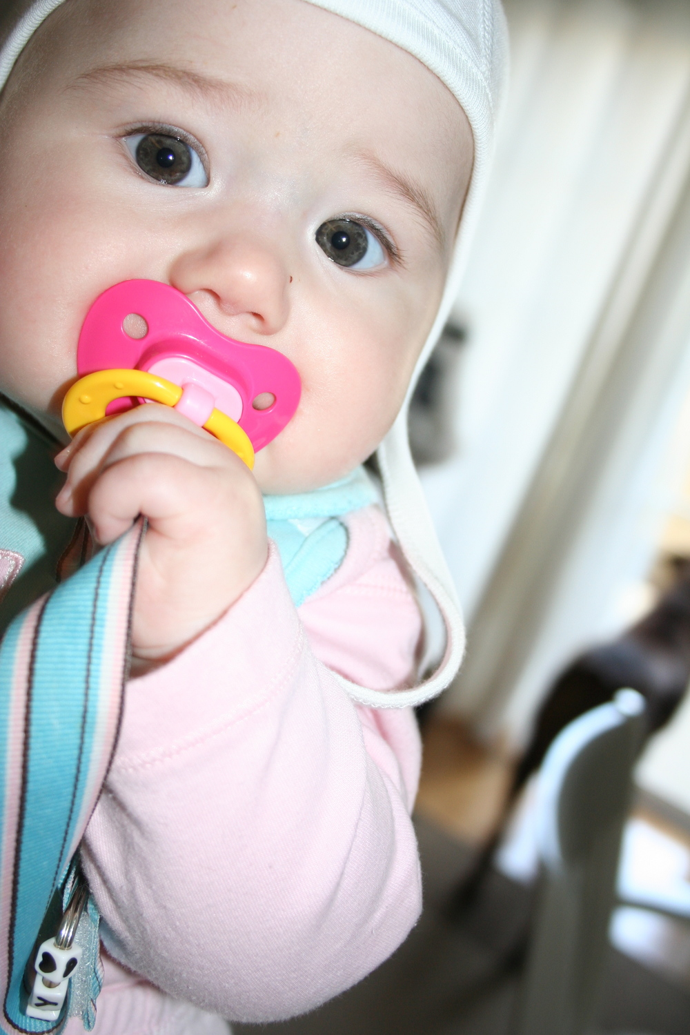 audrey was slightly addicted to her pacifier.