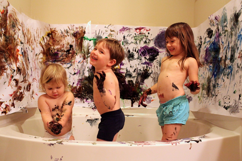 This picture is all I need to remember our bathtub finger paint wall murals, now its perfect gift wrapping paper!