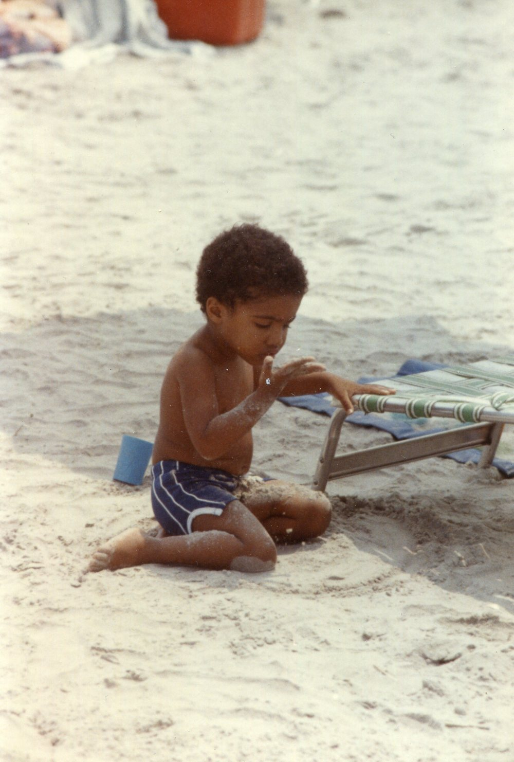 My son playing in the sand, not interested in people, 1982.