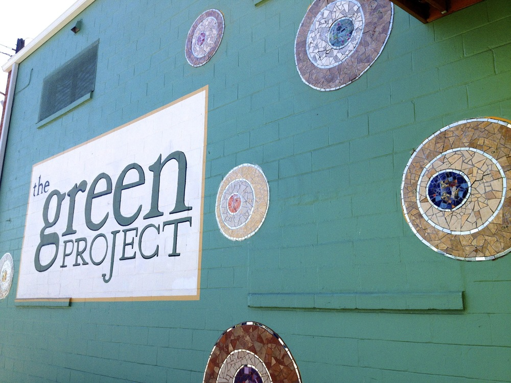 Facade at The Green Project: Mosaic Disks by Laurel True and Students of Global Mosaics Project Facilitator Training Workshop