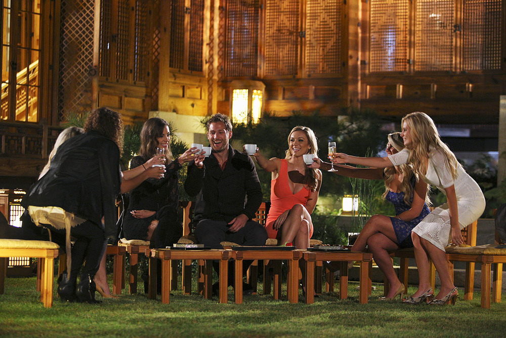 Juan Pablo and the girls doing a group toast during the after party. (Photo by ABC TV/Christopher Jue)