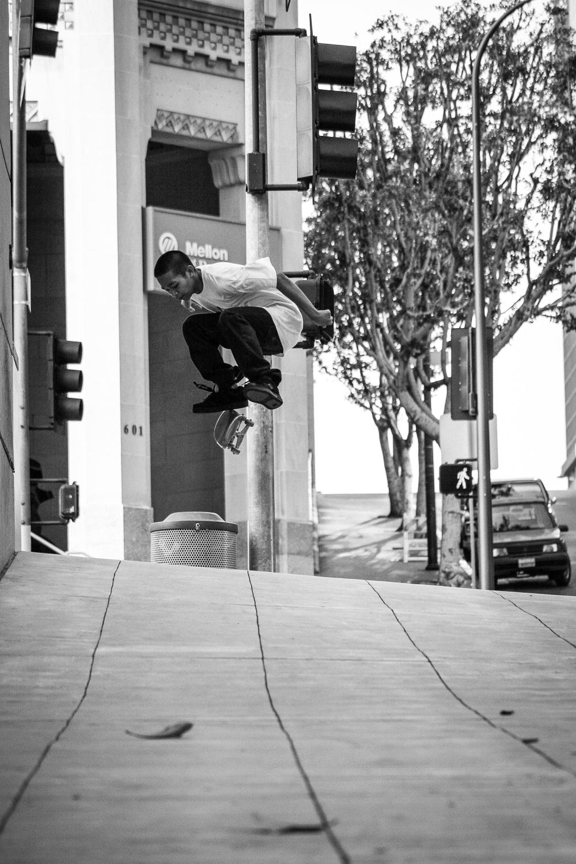 David Coniconde kickflip in downtown Los Angeles, California, 2005.