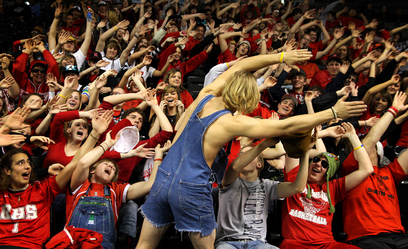 3/10/2011 -- Senior Sam Earhart leads fellow Riverheads High School fans in cheering on the Gladiators during the VHSL semifinal basketball game at the Siegel Center in Richmond.