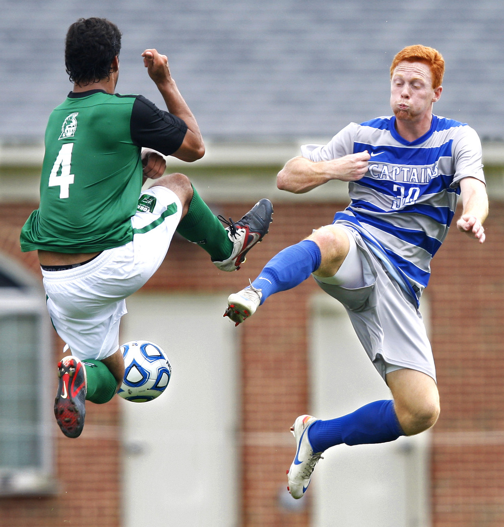 9/2/12 -- York defender Matty Martinez and CNU forward T.J. Byrd go airborne trying to maintain possession in the first half.