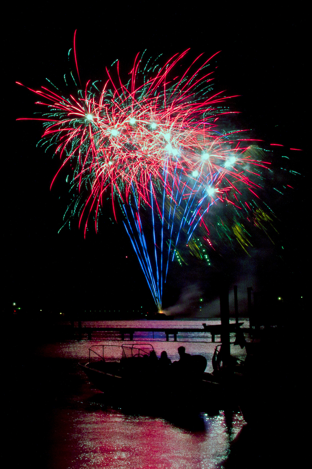 7/1/12 -- Spectators on a boat celebrating the July 4 holiday watch fireworks erupt over Deep Creek in Newport News.