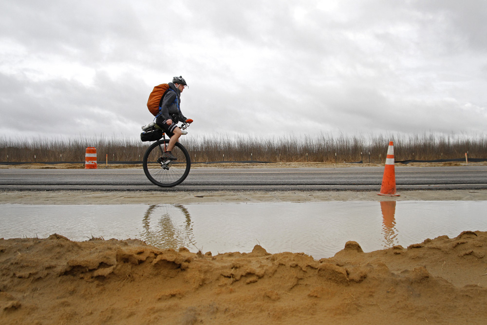 3/12/13 -- Jeffrey Erickson, of Herkimer, New York, rides west on U.S. Route 158 through a construction zone in Elizabeth City, N.C. Erickson left Kitty Hawk on Monday and plans to spend the next 76 days unicycling across the country, finishing near San Francisco, Calif.