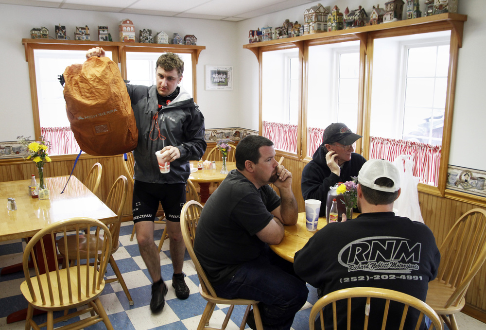 Erickson leaves with his backpack after stopping at a diner in Elizabeth City, N.C.