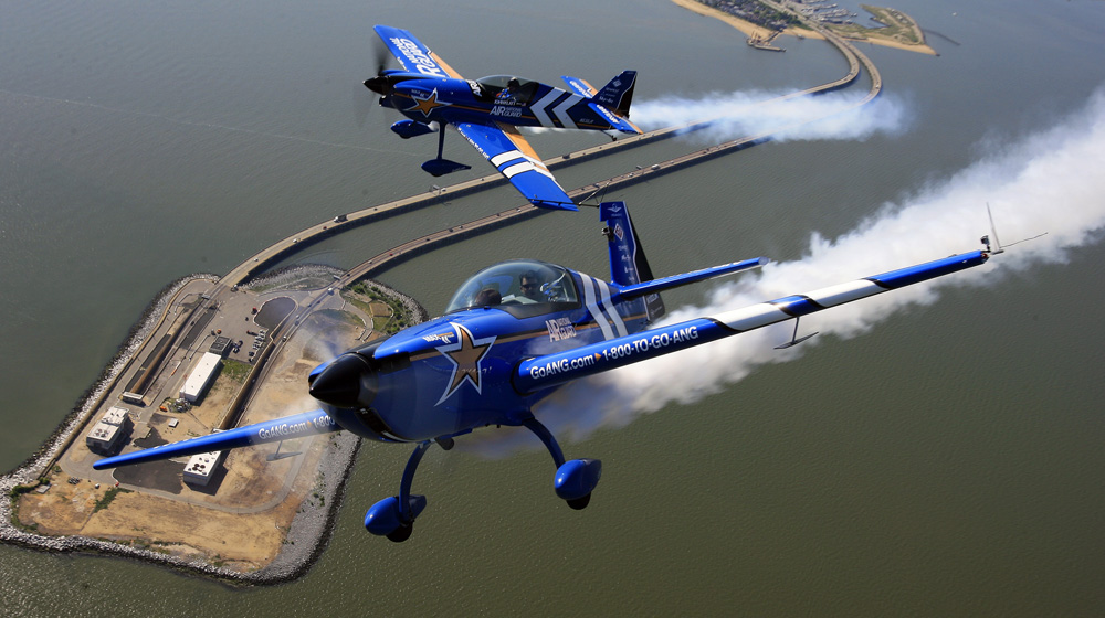 Air National Guard Lt. Col. John Klatt in the Extra 300L, bottom, and Jeff Boerboon in the MXS fly over the Hampton Roads Bridge-Tunnel for an aerobatics demonstration on Thursday, May 30.
