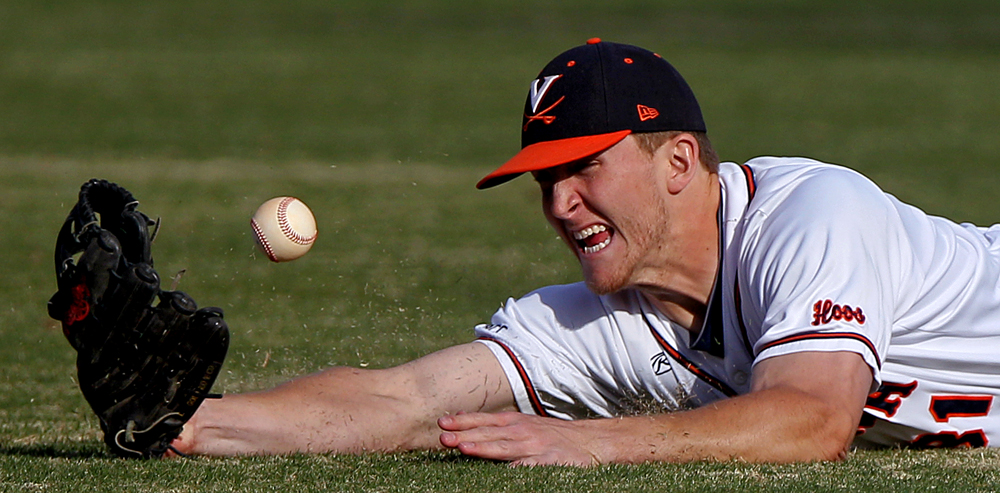 Virginia right fielder Joe McCarthy (31) can't haul in a diving catch during the first inning of an NCAA baseball game against Boston College on March 14, 2014 in Charlottesville, Va. Virginia won 8-1.