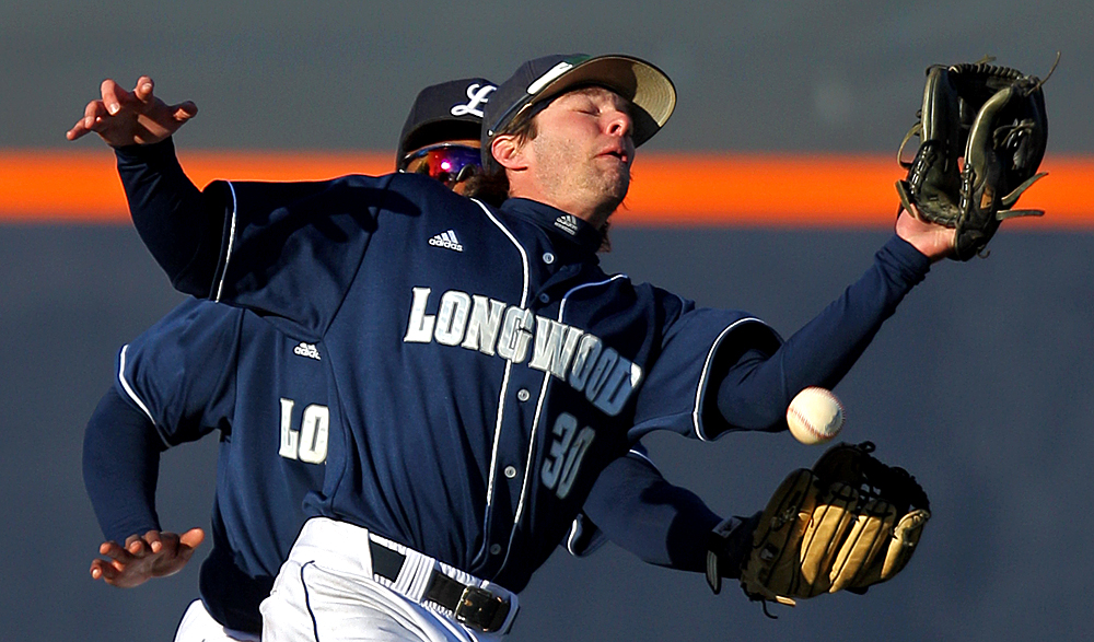 Longwood shortstop Matt Dickason (30) and left fielder Kyri Washington (10) can't haul in a pop fly during the fourth inning of an NCAA baseball game against Virginia on March 26, 2014 in Charlottesville, Va. Virginia won 8-1.