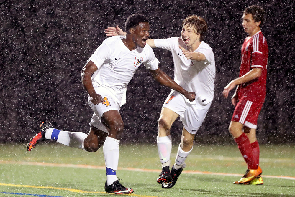 Charlottesville midfielder Amdane Sanda (4) celebrates scoring a goal during a soccer game as rain falls in Charlottesville, Virginia on Wednesday, May 24, 2017. Charlottesville defeated Liberty Christian 5-2 to win the Conference 23 championship.