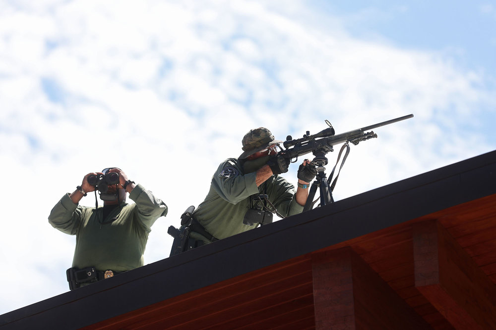 Charlottesville SWAT team members set up on the roof of the Downtown Transit Station before a press conference called by Jason Kessler outside City Hall on Sunday, August 13, 2017, the day after the Unite the Right Rally.