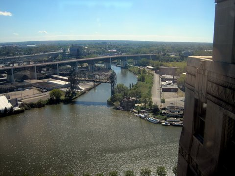 View of riverfront protection and future site of towpath along Cuyahoga River in Cleveland