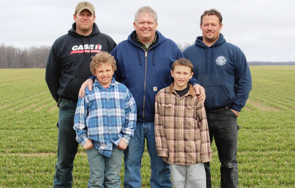 The Smith family farmers are (top row, left to right) Jeremy, Rich and Brian, who are standing behind youngsters Kyle, left, and Brandon.