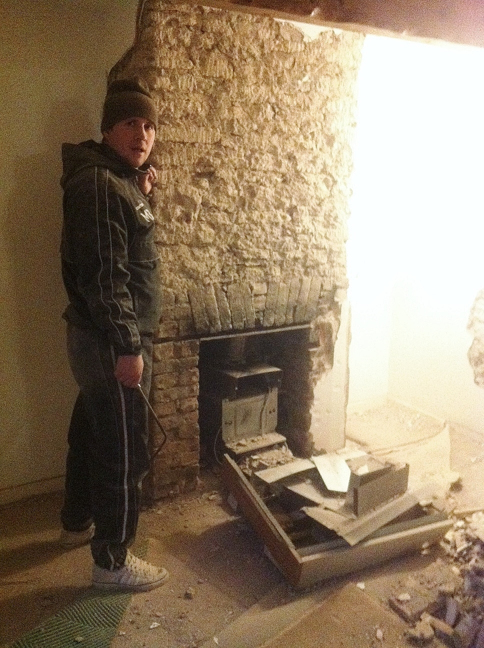 Revealing the original fireplace behind a gas fire...