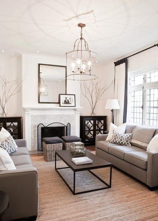Fireplace feature, clean crisp walls, dark olive or grey accents and a real sense of space.