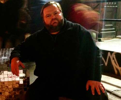 Mike Daisey. You can trust the man who wears the beard, as long as he isn't singing.