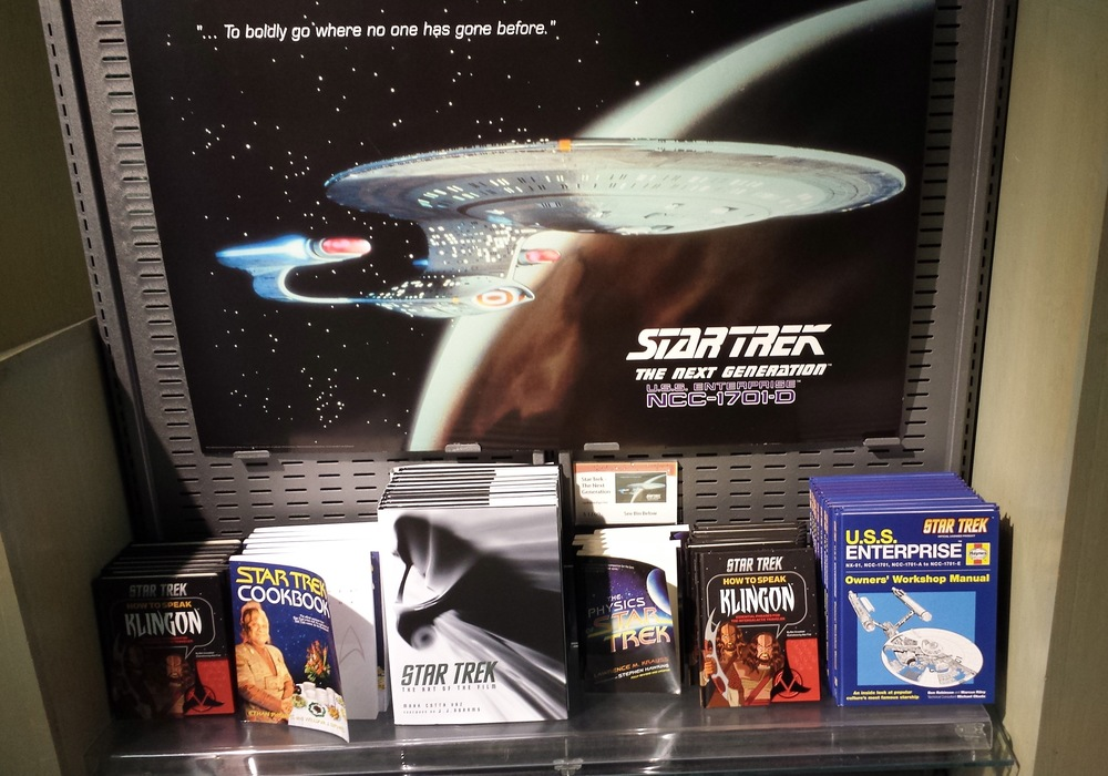 The  Enterprise  is surrounded by  Star Trek  merch.