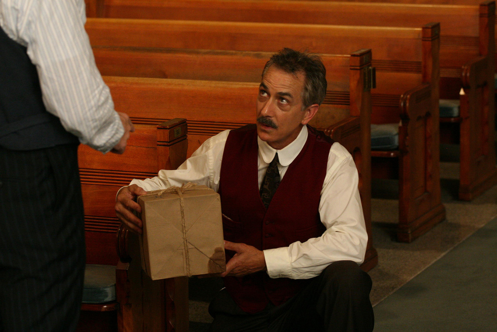 Handle with Care: Cool Hand David Strathairn defuses a package bomb in  No God, No Master.