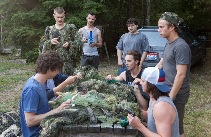Jonathan Daniel Brown (center, with glasses) plays real-life pot smuggler Nate Norman in  Kid Cannabis.