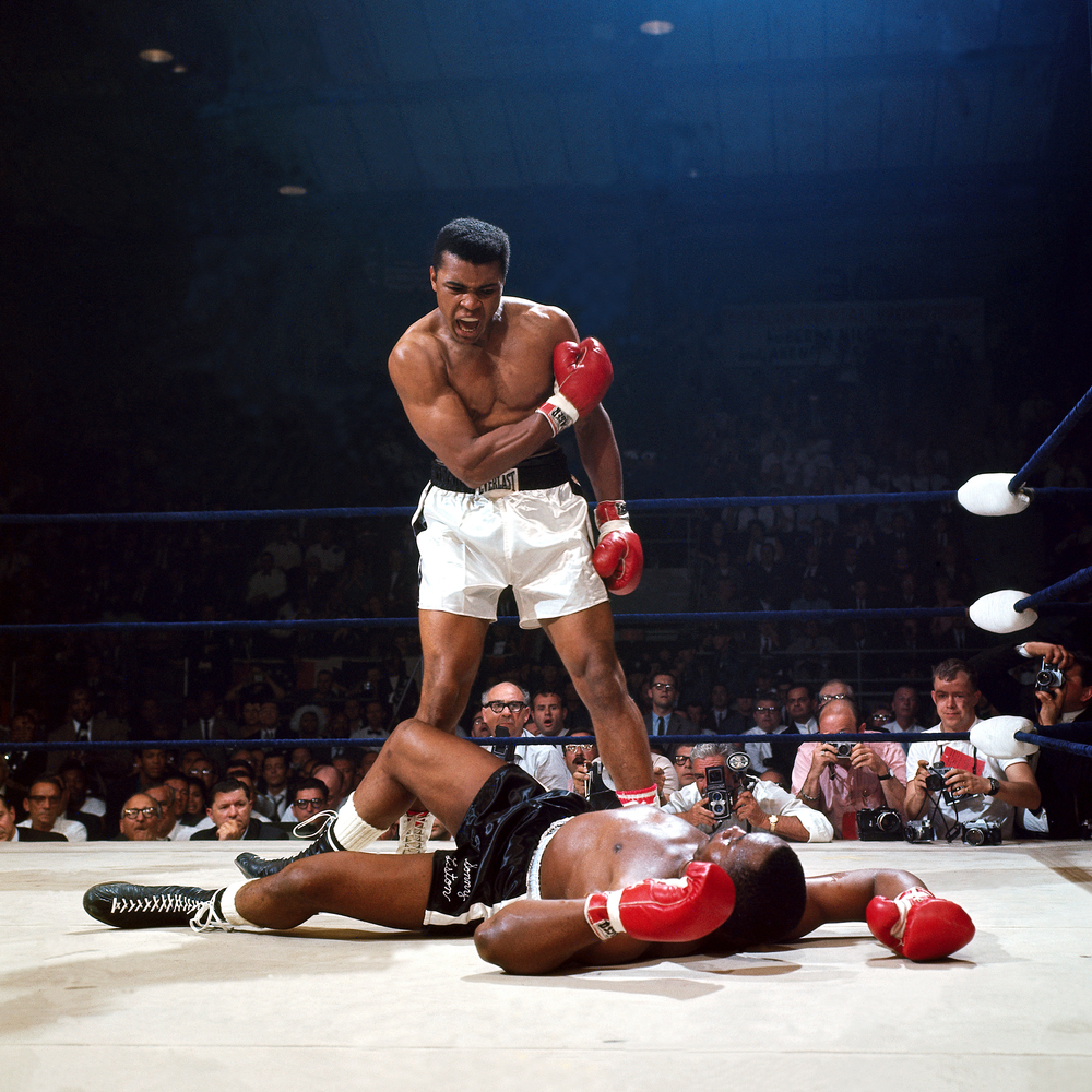 "Neil Leifer's iconic photograph captured the aftermath of the controversial ""phantom punch"" with which Ali felled Sonny Liston for the second and final time, in 1965."