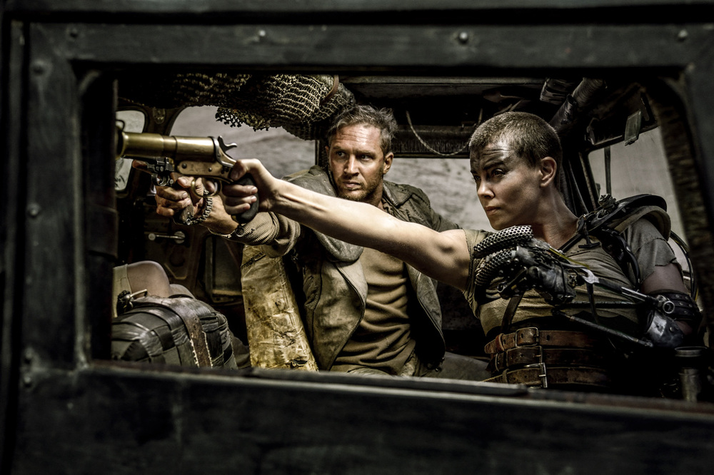 Tom Hardy & Charlize Theron play the dual protagonists of the fourth, and best,  Max Max.