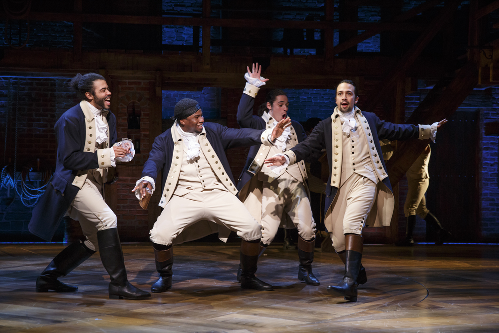 Hamilton.  Lin-Manuel Miranda, at far right, wrote the show and plays the title role.