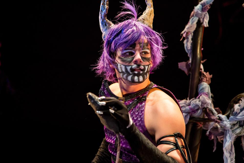 Alex Mills as the Cheshire Cat (Johnny Shryock)