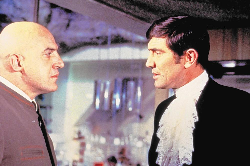 One-and-done Blofeld Telly Savalas meets one-off 007 George Lazenby in  On Her Majesty's Secret Service,  1969.