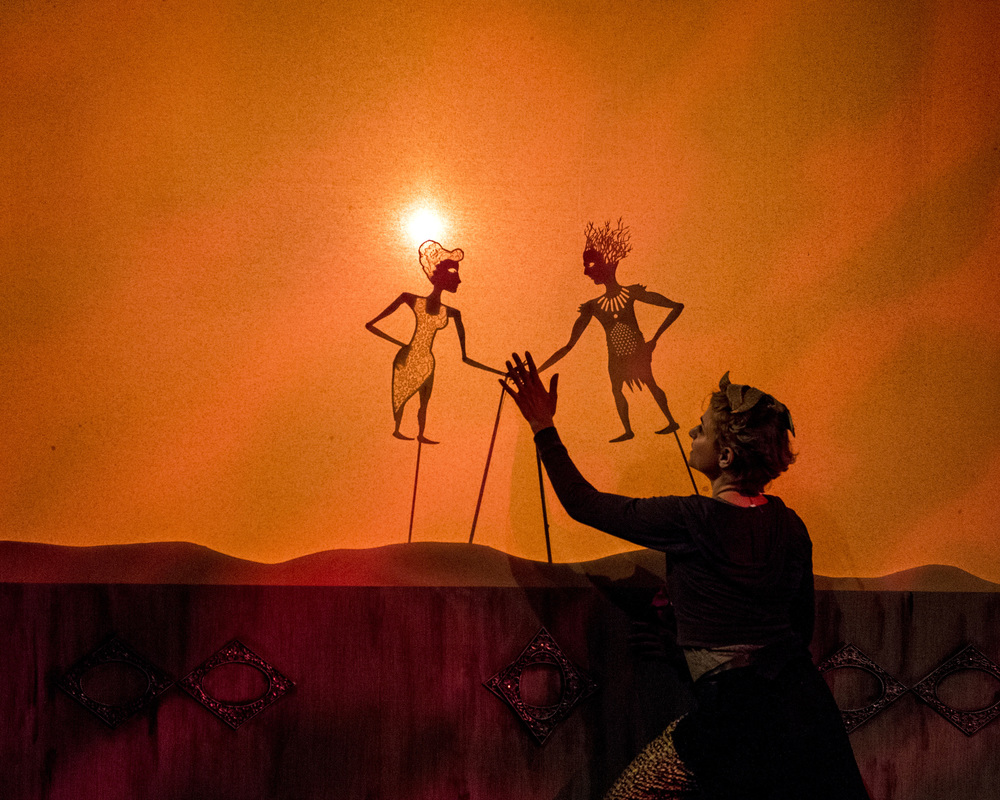 Daven Ralston as Puck with Alex Vernon's shadow puppets of Titania and Oberon in WSC Avant Bard's  A Midsummer Night's Dream.
