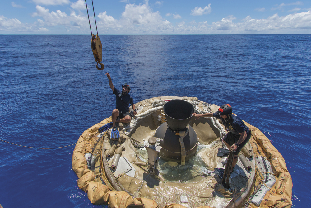 Divers recover the test vehicle for the Low-Density Supersonic Decelerator following its first atmospheric test flight in June 2014 (NASA/JPL).