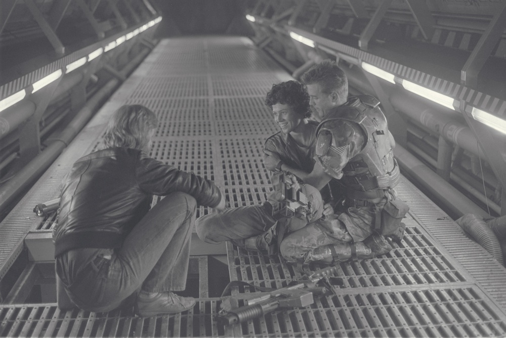 Writer/director James Cameron with Sigourney Weaver and Michael Biehn on the Pinewood Studios set of  ALIENS  circa 1985. (Fox)