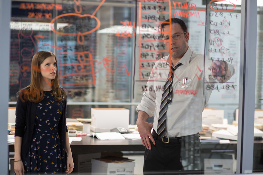 Anna Kendrick and Ben Affleck throw discretion to the glass. (Chuck Zlotnick/Warner Bros.)
