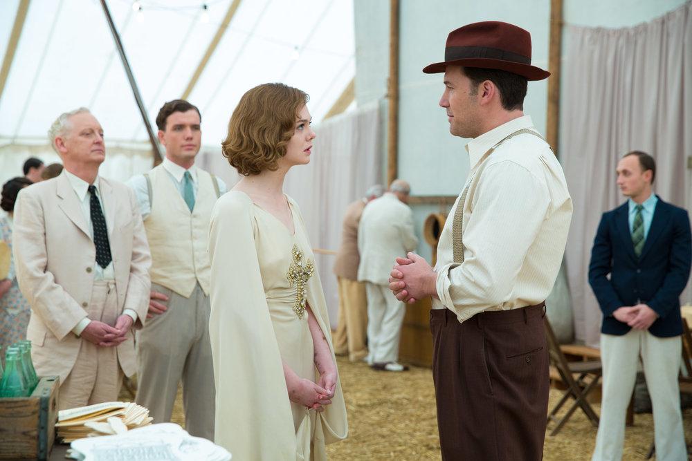 Elle Fanning and Ben Affleck face off. (Claire Folger/Warner Bros.)