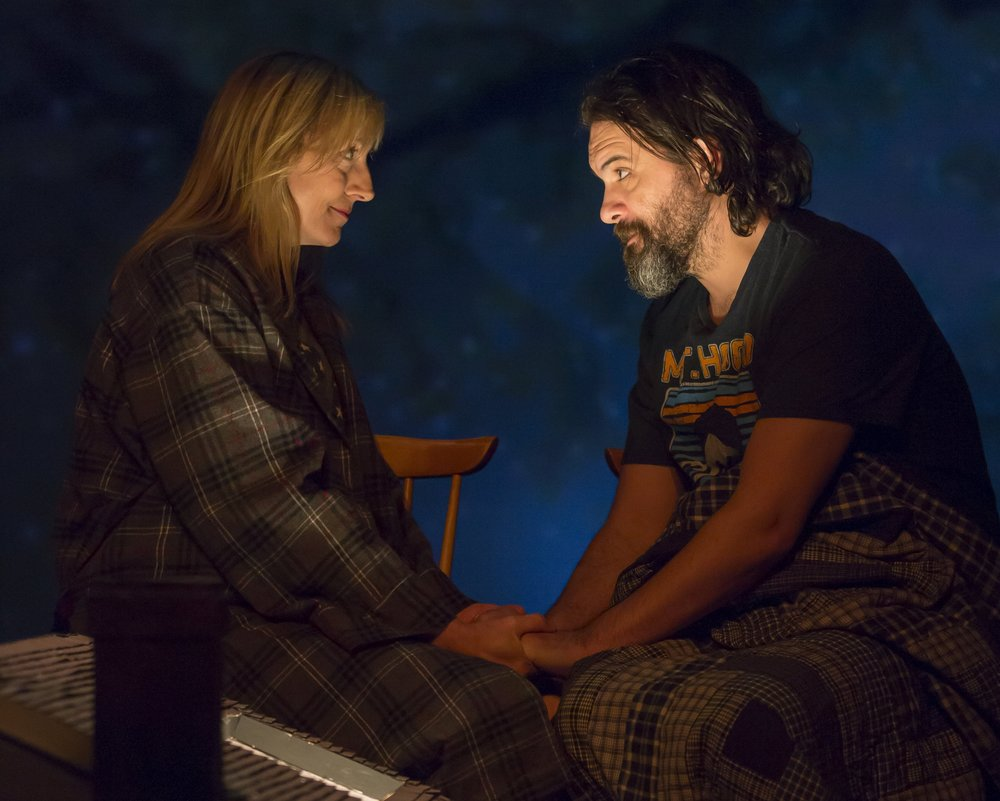 Kate Eastwood Norris and Cody Nickell pray together.(Scott Suchman/Woolly Mammoth)
