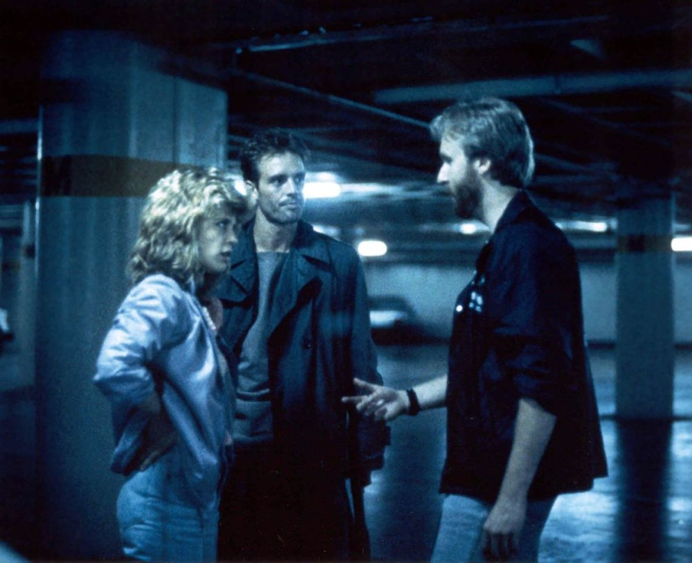 Linda Hamilton and Michael Biehn on the set of  The Terminator  with writer-director James Cameron.