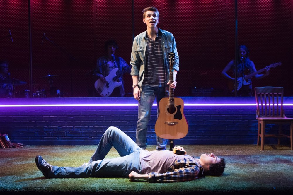 James Lukas Miller (standing) and Jimmy Mavrikes sing Sweetly to one another in Signature's  Girlfriend .