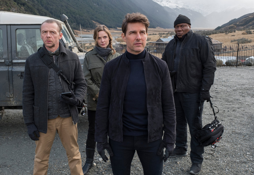 Simon Pegg, Rebecca Ferguson, Tom Cruise, and Ving Rhames.
