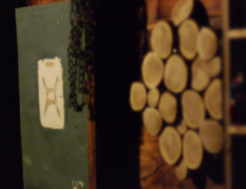 cedar rounds on wood panel