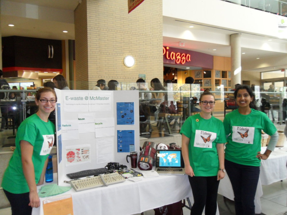 Melissa Gallina, left, along with students in the GUCEL program, promote E-waste initiatives at McMaster Sustainability Day | Obtained with permission from Melissa Gallina