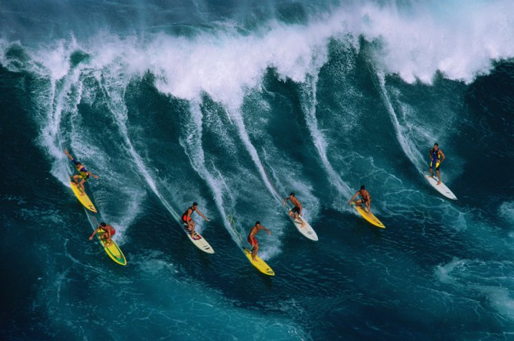 Seven surfers riding a giant wave in Waimea Bay, Hawaii, USA                                                 Credit: Warren Bolster via Getty Images